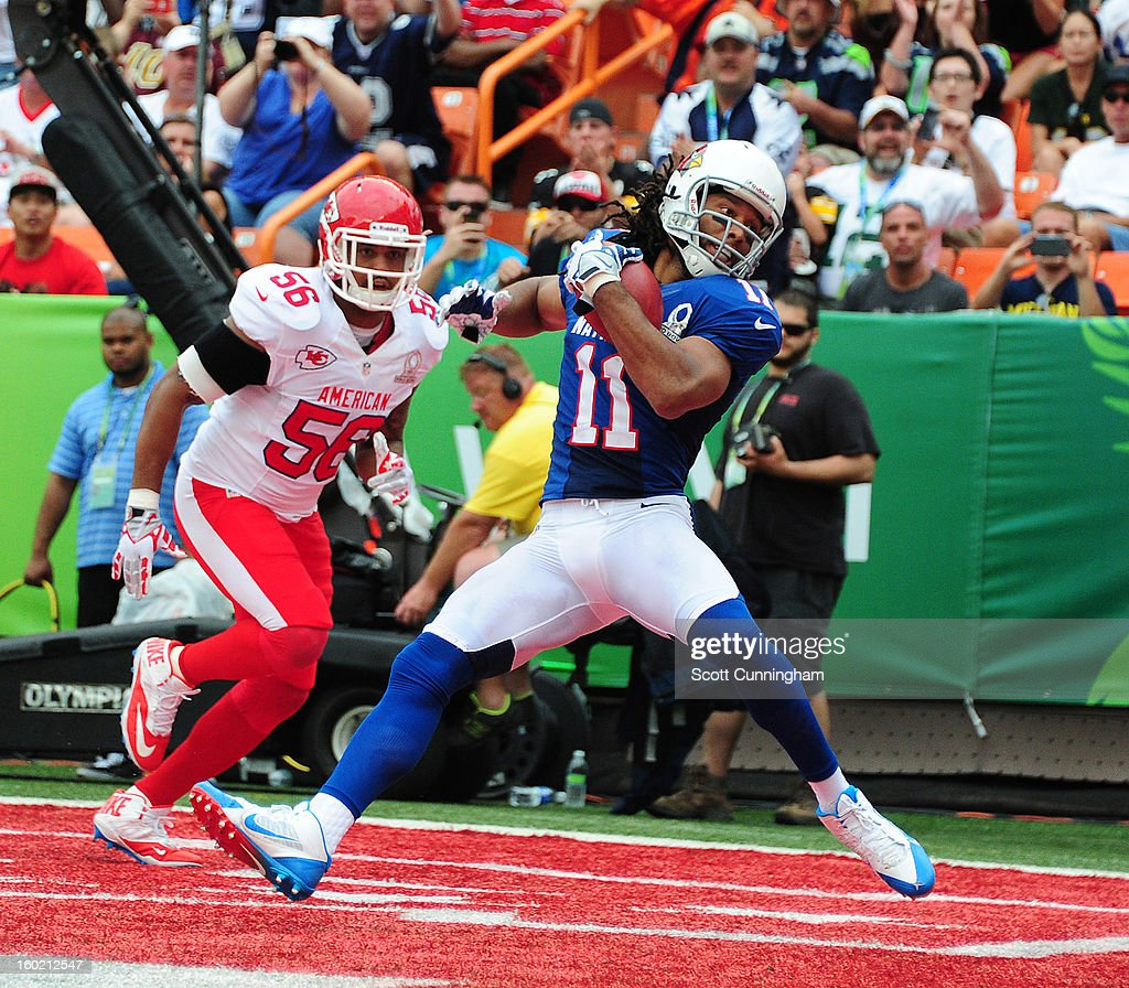 Larry Fitzgerald #11 of the Arizona Cardinals and the NFC makes a catch for a touchdown against the American Football Conference team during the 2013 Pro Bowl at Aloha Stadium on January 27, 2013 in Honolulu, Hawaii
