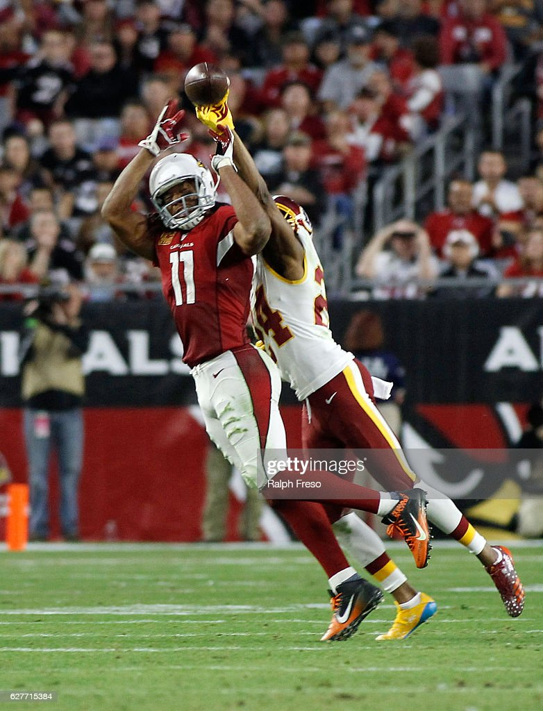 Larry Fitzgerald #11 of the Arizona Cardinals attempts to catch a pass as Josh Norman #24 of the Washington Redskins defends during the fourth quarter of a game at University of Phoenix Stadium on December 4, 2016 in Glendale, Arizona. The Cardinals defeated the Redskins 31-23.