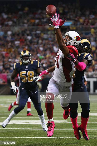 Larry Fitzgerald of the Arizona Cardinals attempts to catch a pass against the St Louis Rams at the Edward Jones Dome on October 4 2012 in St Louis...