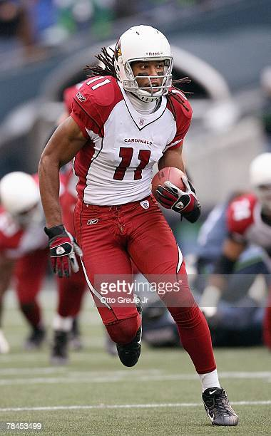 Larry Fitzgerald of the Arizona Cardinals carries the ball during the game against the Seattle Seahawks at Qwest Field December 9, 2007 in Seattle,...