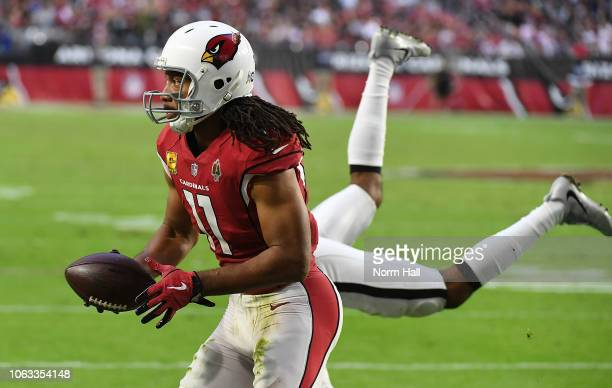Larry Fitzgerald of the Arizona Cardinals catches a touchdown pass during the second half against the Oakland Raiders at State Farm Stadium on...