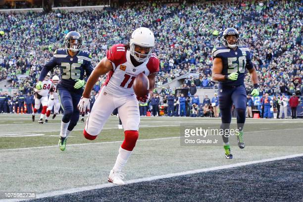 Larry Fitzgerald of the Arizona Cardinals catches the ball for a touchdown in the second quarter against the Seattle Seahawks at CenturyLink Field on...