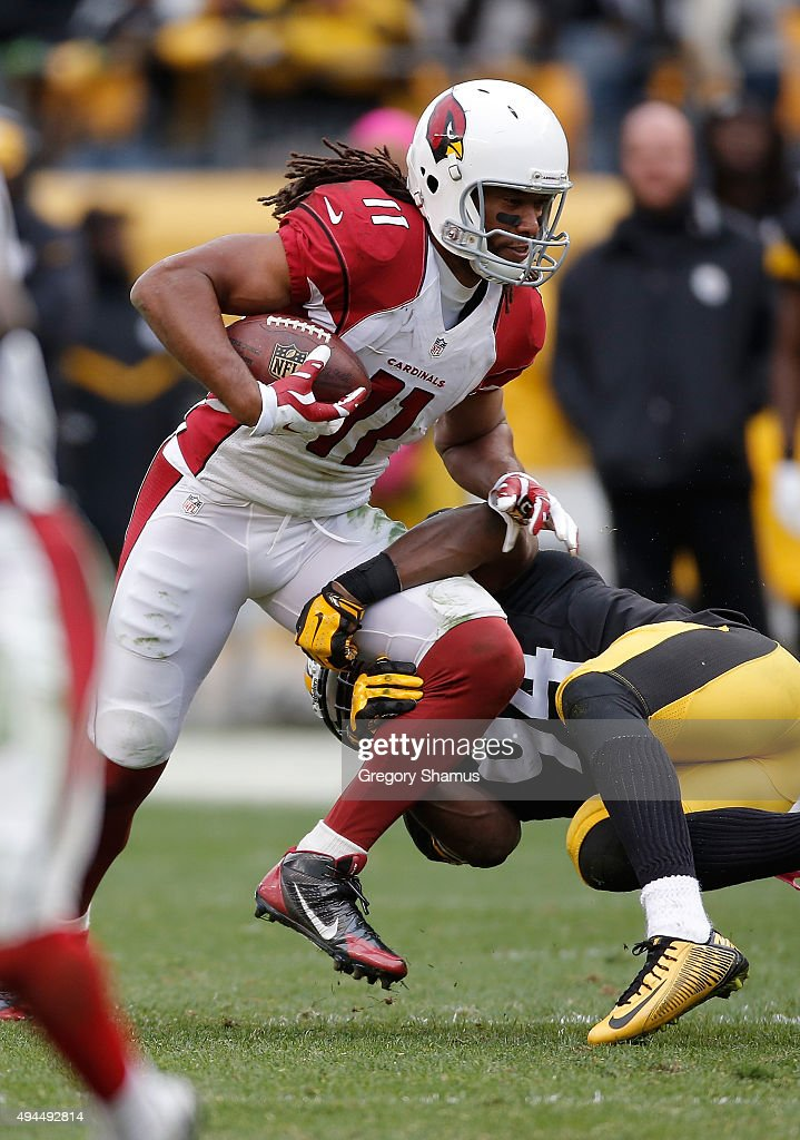 Larry Fitzgerald #11 of the Arizona Cardinals gets tackled by Lawrence Timmons #94 of the Pittsburgh Steelers at Heinz Field on October 18, 2015 in Pittsburgh, Pennsylvania.