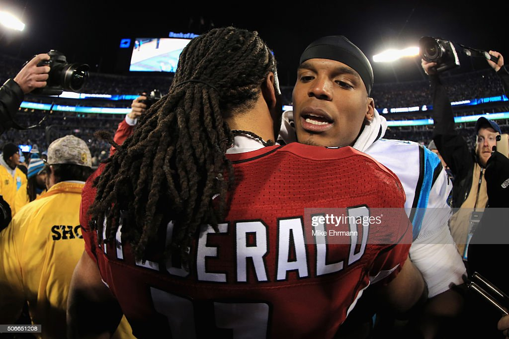 Larry Fitzgerald #11 of the Arizona Cardinals greets Cam Newton #1 of the Carolina Panthers after the Carolina Panthers defeated the Arizona Cardinals with a score of 49 to 15 to win the NFC Championship Game at Bank of America Stadium on January 24, 2016 in Charlotte, North Carolina.