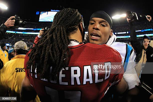 Larry Fitzgerald of the Arizona Cardinals greets Cam Newton of the Carolina Panthers after the Carolina Panthers defeated the Arizona Cardinals with...