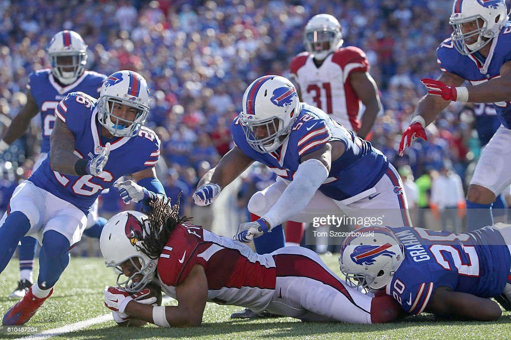 Larry Fitzgerald #11 of the Arizona Cardinals is gang tackled by the Buffalo Bills during the second half at New Era Field on September 25, 2016 in Orchard Park, New York.