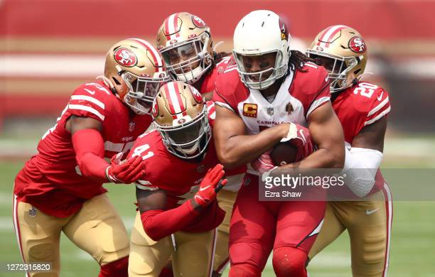 Larry Fitzgerald of the Arizona Cardinals is group tackled by the San Francisco 49ers at Levi's Stadium on September 13 2020 in Santa Clara California