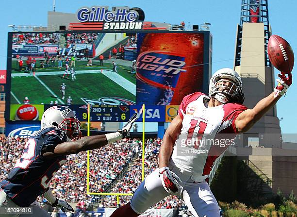 Larry Fitzgerald of the Arizona Cardinals is unable to catch a ball as Devin McCourty of the New England Patriots defends in the second half at...