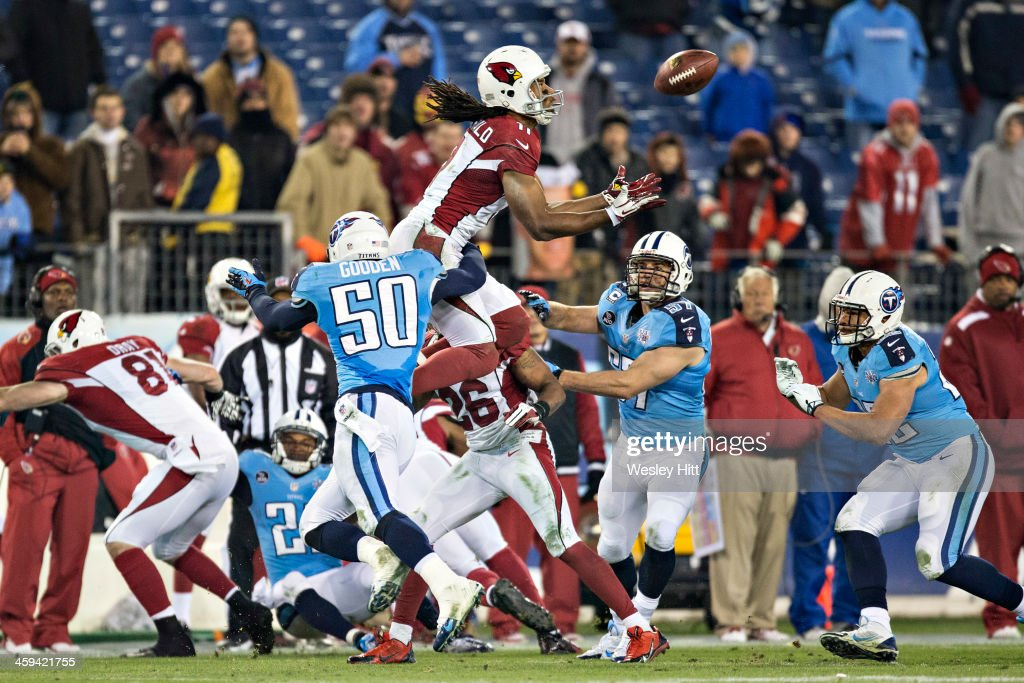 Larry Fitzgerald #11 of the Arizona Cardinals jumps to get a on side kickoff but is hit and fumbles the ball against the Tennessee Titans at LP Field on December 15, 2013 in Nashville, Tennessee. The Cardinals defeated the Titans 37-34.