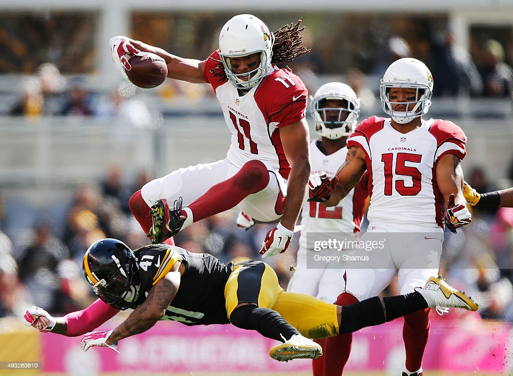 Larry Fitzgerald #11 of the Arizona Cardinals leaps over Antwon Blake #41 of the Pittsburgh Steelers in the 1st half of the gmae at Heinz Field on October 18, 2015 in Pittsburgh, Pennsylvania.