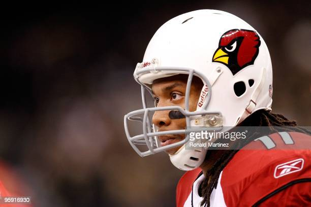 Larry Fitzgerald of the Arizona Cardinals looks on against the New Orleans Saints during the NFC Divisional Playoff Game at Louisana Superdome on...