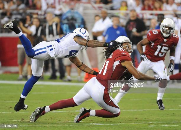 Larry Fitzgerald of the Arizona Cardinals makes a 16yard catch as Antoine Bethea of the Indianapolis Colts grabs his facemask for a 15yard penalty in...