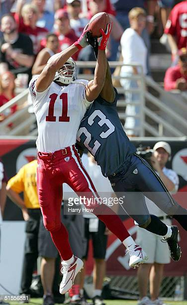 Larry Fitzgerald of the Arizona Cardinals makes a catch over Marcus Trufant of the Seattle Seahawks for a touchdown and a 70 lead in the first...