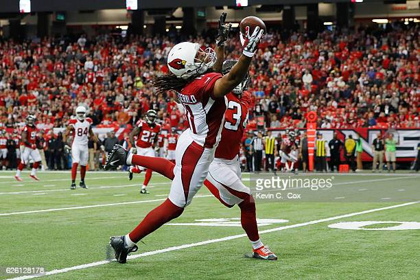 Larry Fitzgerald of the Arizona Cardinals makes a onehanded catch against Brian Poole of the Atlanta Falcons during the first half at the Georgia...
