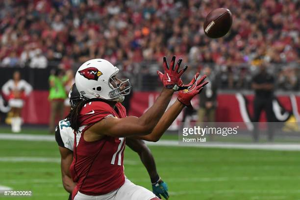 Larry Fitzgerald of the Arizona Cardinals makes a pass in the first half against the Jacksonville Jaguars at University of Phoenix Stadium on...