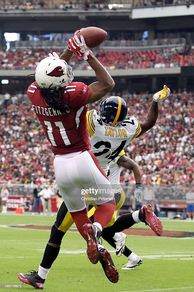 Larry Fitzgerald #11 of the Arizona Cardinals makes a reception over Ike Taylor #24 of the Pittsburgh Steelers during the first quarter at University of Phoenix Stadium on October 23, 2011 in Glendale, Arizona.