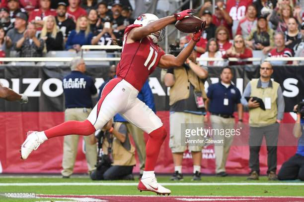Larry Fitzgerald of the Arizona Cardinals makes an 18 yard touchdown reception in the first half of the NFL game against the Oakland Raiders at State...