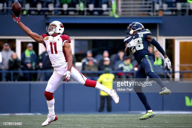 Larry Fitzgerald of the Arizona Cardinals reaches for a pass against Justin Coleman of the Seattle Seahawks in the second quarter during their game...
