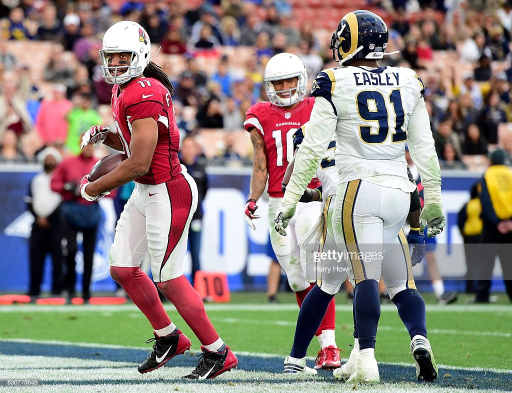 Larry Fitzgerald #11 of the Arizona Cardinals reacts to his touchdown in front of Dominique Easley #91 of the Los Angeles Rams to take a 44-6 lead during the fourth quarter at Los Angeles Memorial Coliseum on January 1, 2017 in Los Angeles, California.