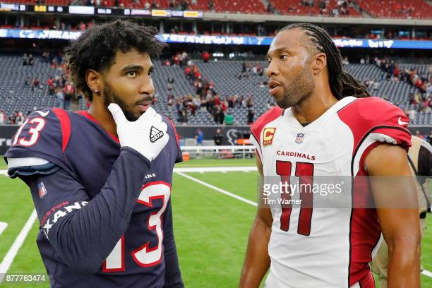 Larry Fitzgerald of the Arizona Cardinals talks with Braxton Miller of the Houston Texans after the game at NRG Stadium on November 19 2017 in...