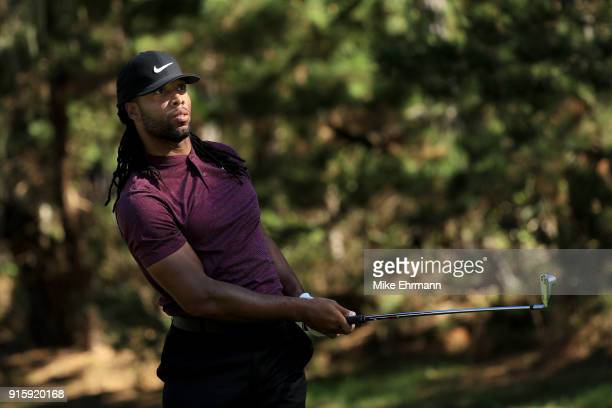 Larry Fitzgerald plays his shot from the 16th tee during Round One of the ATT Pebble Beach ProAm at Spyglass Hill Golf Course on February 8 2018 in...