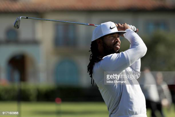 Larry Fitzgerald plays his shot from the sixth tee during the Final Round of the ATT Pebble Beach ProAm at Pebble Beach Golf Links on February 11...