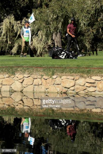 Larry Fitzgerald walks across the 15th green during Round One of the ATT Pebble Beach ProAm at Spyglass Hill Golf Course on February 8 2018 in Pebble...
