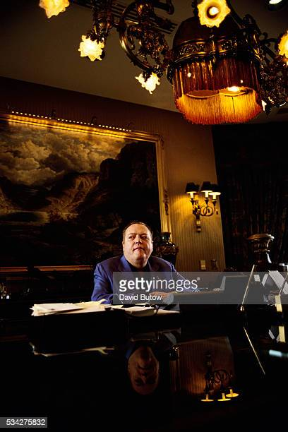 Larry Flynt, publisher of the pornography magazine Hustler, sits at a table in Beverly Hills. In 1998, he is denying accusations of sexual abuse made...