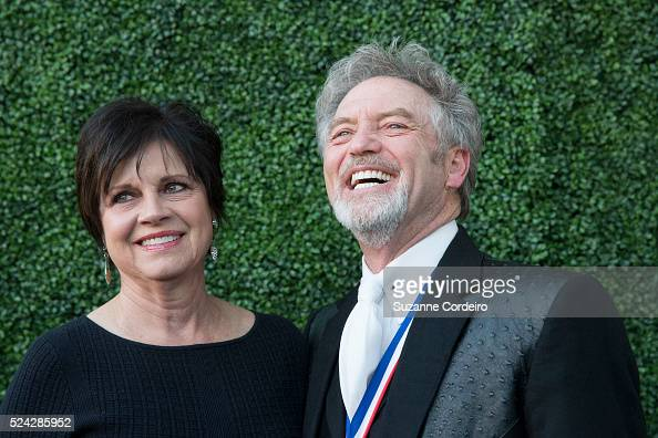 Larry Gatlin And His Wife Janis Ross Pose On The Red