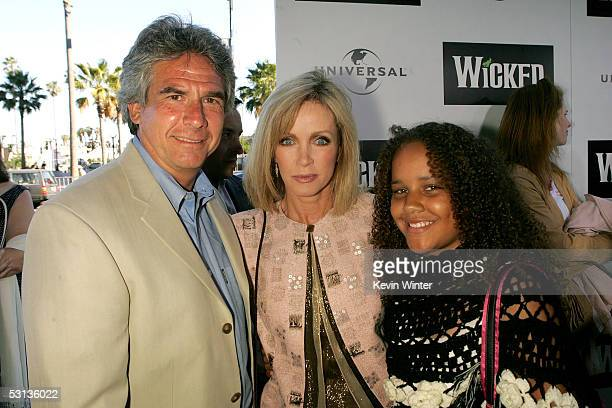 """Larry Gilman, actress Donna Mills and daughter Chloe arrive at the Los Angeles Premiere of the Broadway musical """"Wicked"""" at the Pantages Theatre on..."""