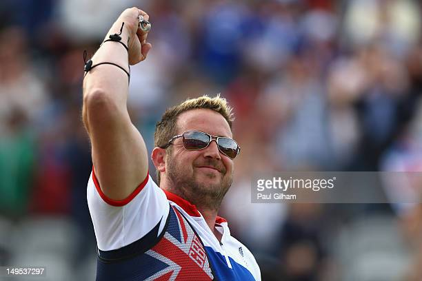 Larry Godfrey of Great Britain celebrates winning his Men's Individual Archery 1/32 Eliminations match against Juan Rene Serrano of Mexico on Day 3...