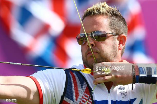 Larry Godfrey of Great Britain competes in his Men's Individual 1/32 Eliminations Archery match against Emdadul Haque Milon of Bangladesh on Day 3 at...