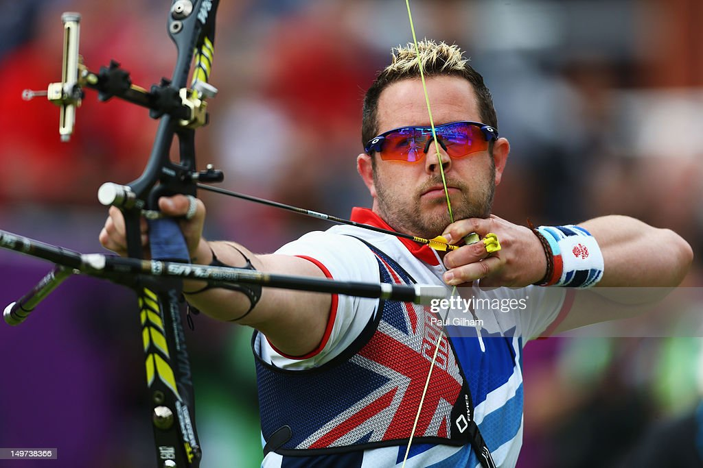 Larry Godfrey of Great Britain competes in his Men's Individual Archery 1/8 Eliminantions match against Khairul Anuar Mohamad of Malaysia during the Men's Individual Archery on Day 7 of the London 2012 Olympic Games at Lord's Cricket Ground on August 3, 2012 in London, England.