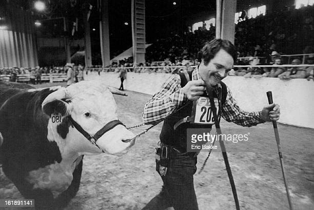 JAN 18 1981 JAN 18 1982 JAN 19 1982 Larry Hagenbuch parades the grand champion Hereford bull of 1982 National Western Stock Show