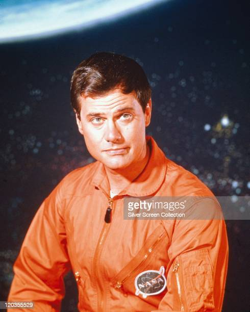 Larry Hagman US actor wearing orange overalls with the NASA badge issued as publicity for the US television series 'I Dream of Jeannie' USA circa...