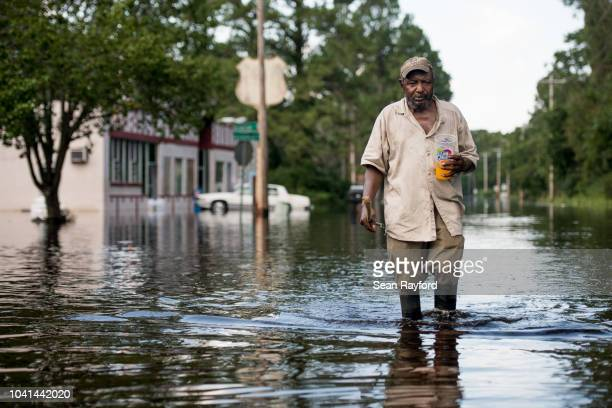 Larry Hickman walks in floodwaters from the Waccamaw River caused by Hurricane Florence on September 26, 2018 in Bucksport, South Carolina. Nearly...
