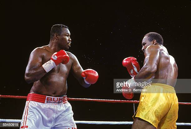 Larry Holmes and Evander Holyfield compete for the WBC WBA IBF Heavyweight Titles in a bout schedule for twelve rounds at Caesars Palace on June 19...