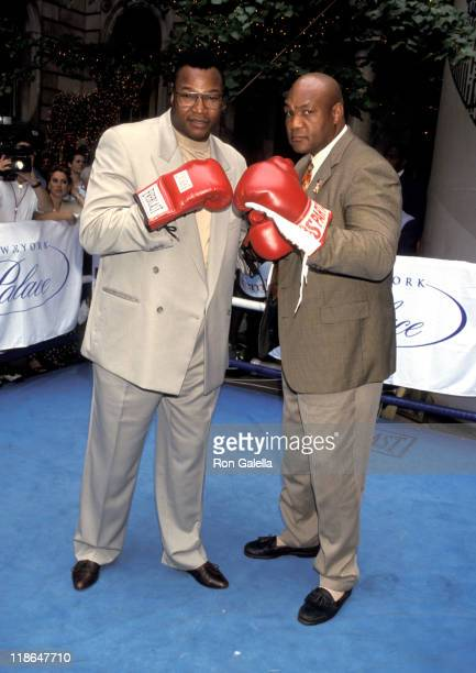 Larry Holmes and George Foreman during George Foreman vs Larry Holmes Press Conference July 15 1998 at Palace Hotel in New York City New York United...