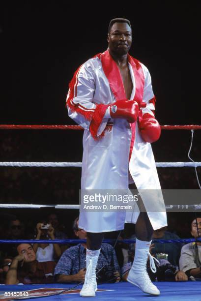 Larry Holmes dances in the ring to keep loose as he challenges Evander Holyfield for the WBC WBA IBF Heavyweight Titles in a bout schedule for twelve...