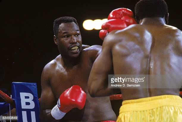 Larry Holmes jabs at Evander Holyfield as they compete for the WBC, WBA, IBF Heavyweight Titles, in a bout schedule for twelve rounds at Caesars...