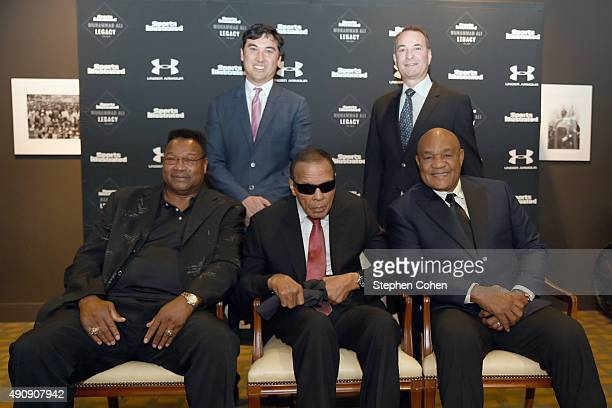 Larry Holmes SI Editor Chris Stone Muhammad Ali Sports Illustrated Group Editor Paul Fichtenbaum and George Foreman attend the Sports Illustrated...