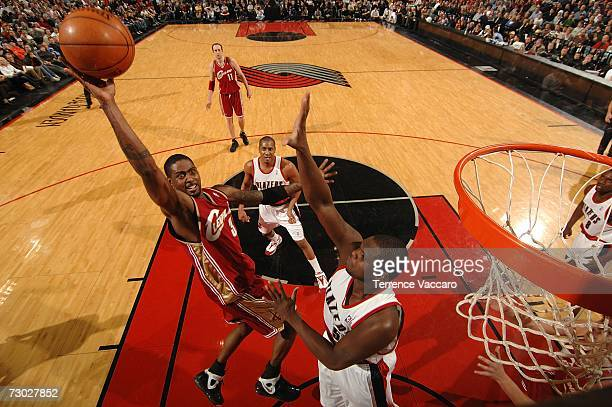 Larry Hughes of the Cleveland Cavaliers goes to the basket against Zach Randolph of the Portland Trail Blazers on January 17 2007 at the Rose Garden...