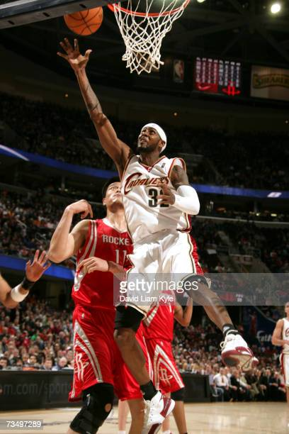 Larry Hughes of the Cleveland Cavaliers takes it in for two past Yao Ming of the Houston Rockets at The Quicken Loans Arena March 5, 2007 in...