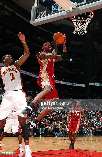 Larry Hughes of the Cleveland Cavaliers takes the ball to the basket against Joe Johnson of the Atlanta Hawks during the game at Philips Arena on...