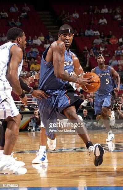 Larry Hughes of the Washington Wizards drives against DeShawn Stevenson of the Orlando Magic on April 1 2005 at TD Waterhouse Centre in Orlando...