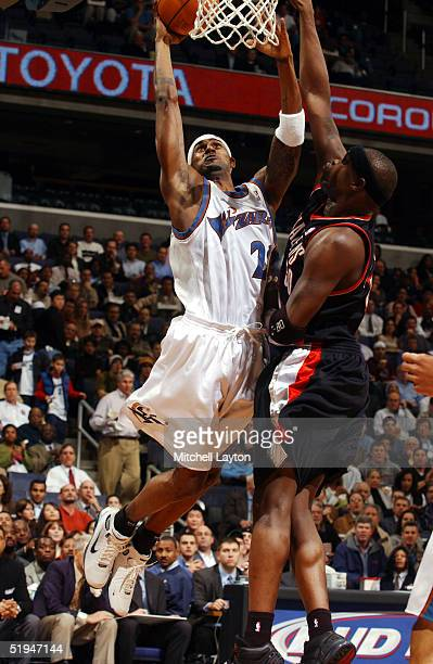 Larry Hughes of the Washington Wizards drives the basket iagainst Zach Randolph of the Portland Trail Blazers January 12 2005 at the MCI Center in...