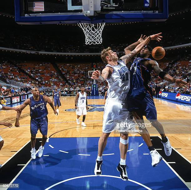 Larry Hughes of the Washington Wizards gets fouled by Mario Kasun of the Orlando Magic during a game at TD Waterhouse Centre on April 1 2005 in...