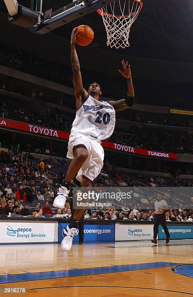Larry Hughes of the Washington Wizards goes for a layup against the Phoenix Suns January 30 2004 at the MCI Center in Washington DC NOTE TO USER User...