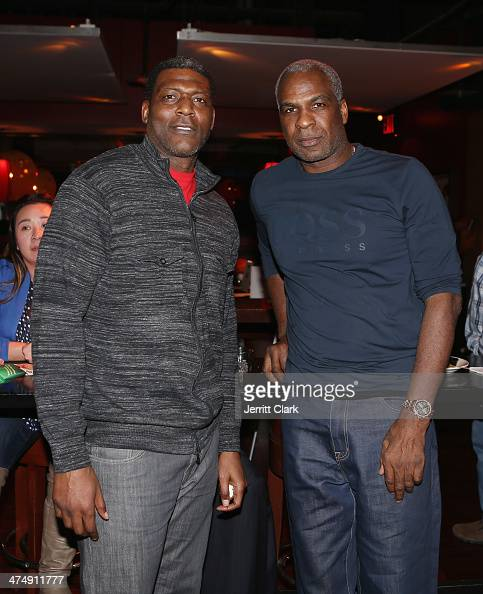 Larry Johnson And Charles Oakley Attend The 2014 John