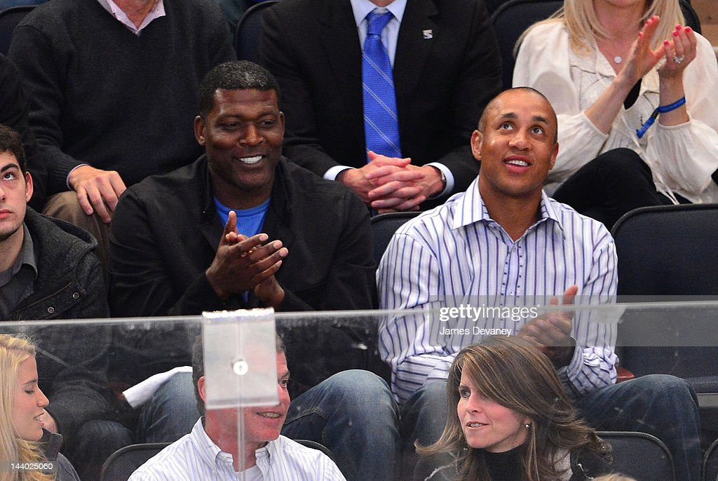Larry Johnson and John Starks attend the Washington Capitals vs New York Rangers playoff game at Madison Square Garden on May 7, 2012 in New York City.